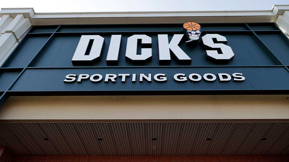 FILE- This Feb. 28, 2018, file photo shows a Dick's Sporting Goods store in Arlington Heights, Ill. Dick's Sporting Goods Inc. said on Tuesday, March 12, 2019, that it will stop selling hunting rifles and ammunition at 125 of its stores, replacing the gear with merchandise it believes will sell better at those locations. (