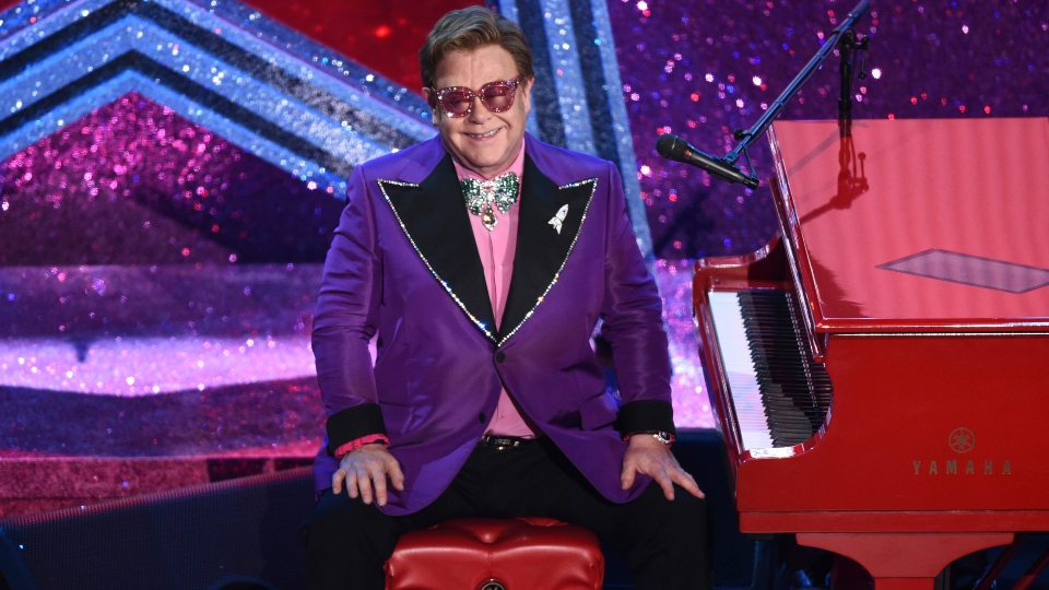 Virus: Elton John-led concert raises $8M; Rihanna ups aid.