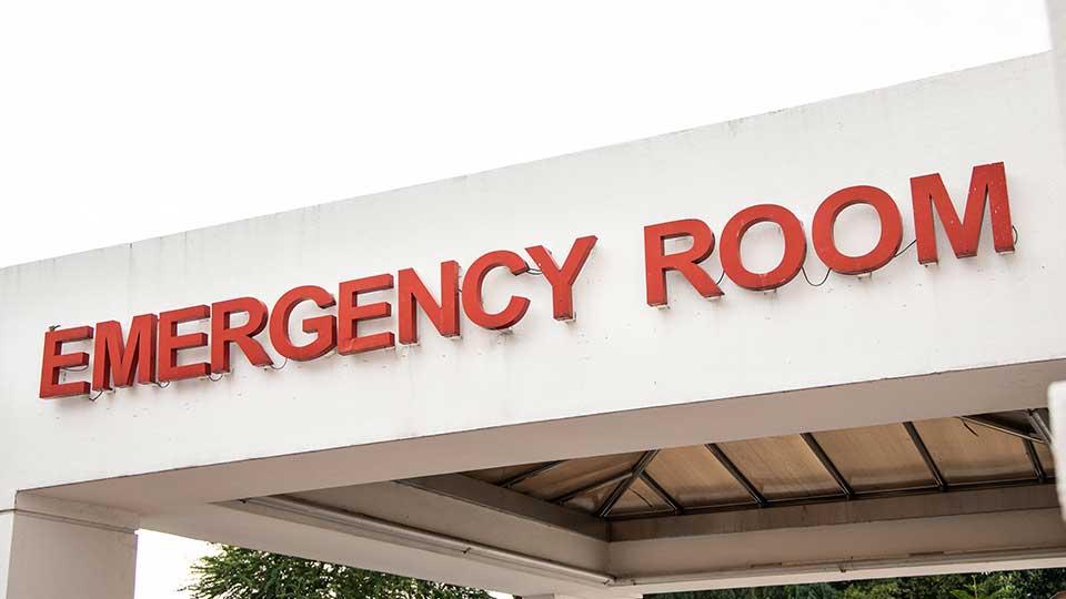 An emergency room sign on a hospital emergency room entrance.