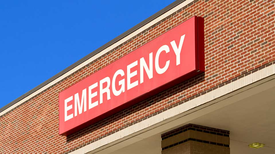 An emergency sign on a hospital emergency room entrance.
