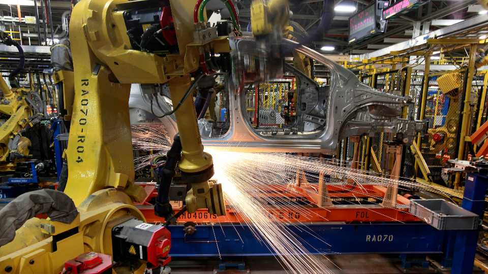 In this May 19, 2011 photo, robots weld a Chevrolet Sonic at the General Motors Orion Assembly plant in Orion Township, Mich. General Motors, Ford, jet engine maker Rolls-Royce and other companies are talking to their governments about repurposing idled factories to produce vital goods to fight the coronavirus such as ventilators and surgical masks. On Friday, March 20, 2020 President Donald Trump invoked the Korean War-era Defense Production Act, allowing the government to marshal the private sector to fight the COVID-19 pandemic. Although it allows the government to steer factories to overcome shortages, makers of heavy goods such as cars and trucks can't just flip a switch and produce something else.