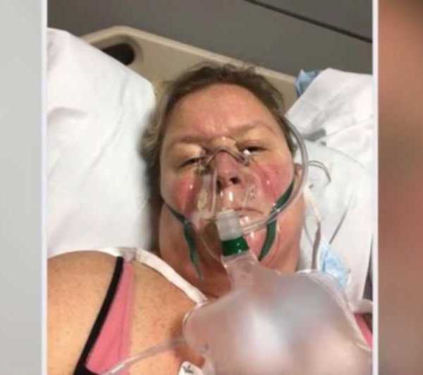 A Geneva mother of four, who tested positive for COVID-19, is now on a ventilator and in a medically induced coma at a Cleveland hospital.