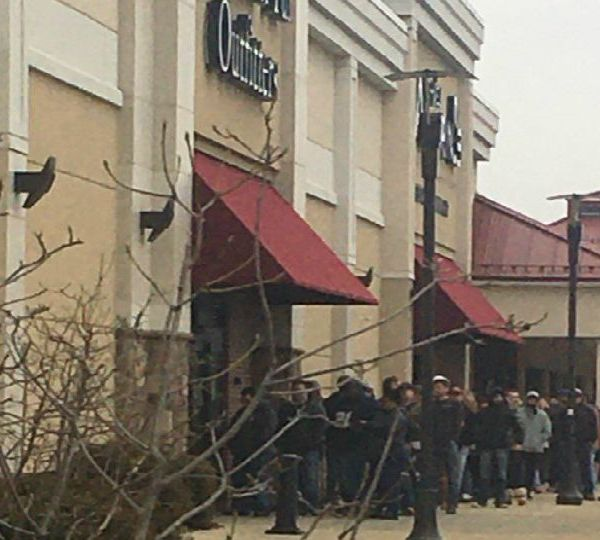 The line was out the door Tuesday at Fin Feather Fur Outfitters in Boardman.