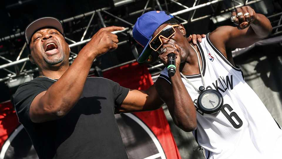 This May 29, 2015 file photo shows Chuck D, left, Flavor Flav of Public Enemy performing at the 2015 BottleRock Napa Valley Music Festival in Napa, Calif. Public Enemy has abruptly fired founding member Flavor Flav following a public spat over the rap group's plan to perform at a Bernie Sanders campaign event.