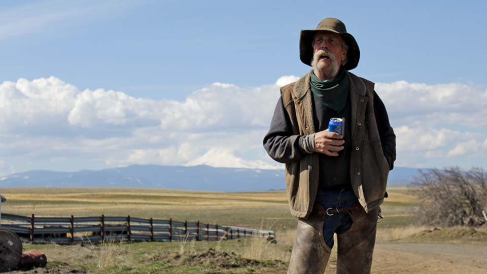 Cattle rancher Mike Filbin stands on his property