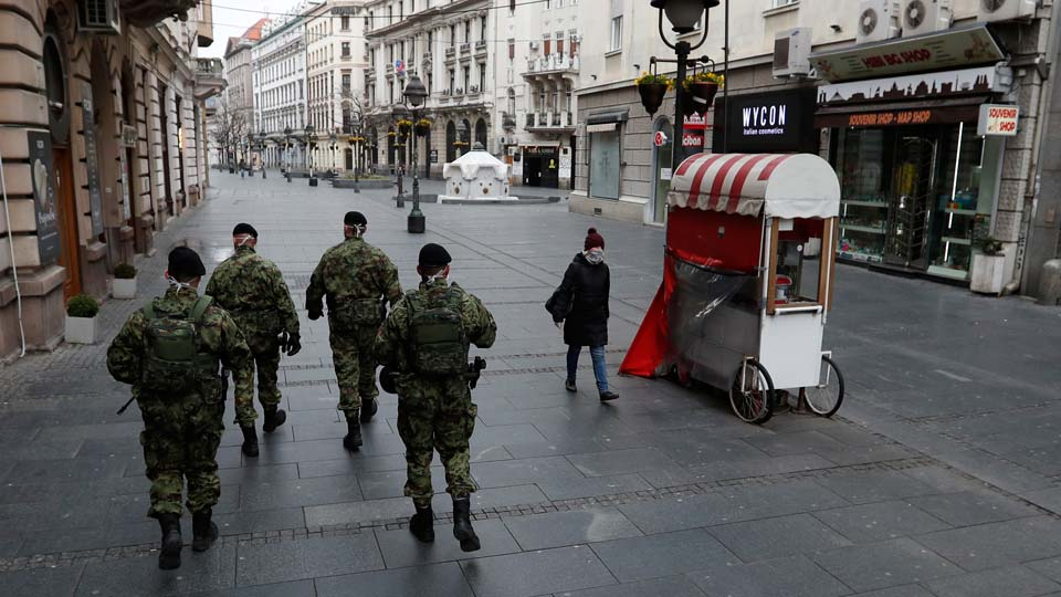 Serbian army soldiers patrol in Belgrade's main pedestrian street