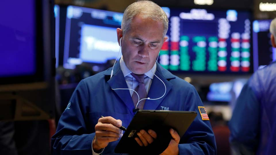 Trader Timothy Nick works on the floor of the New York Stock Exchange