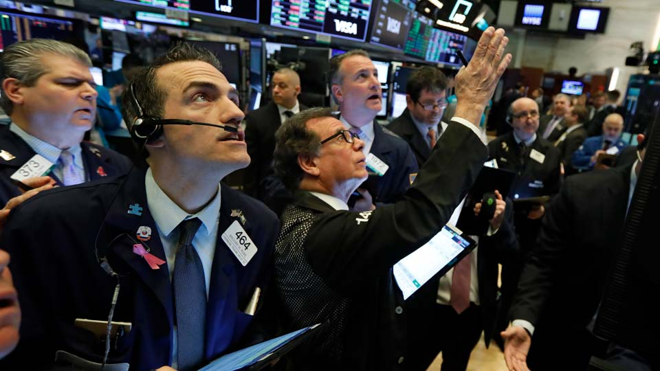 Stock traders gather at the New York Stock Exchange