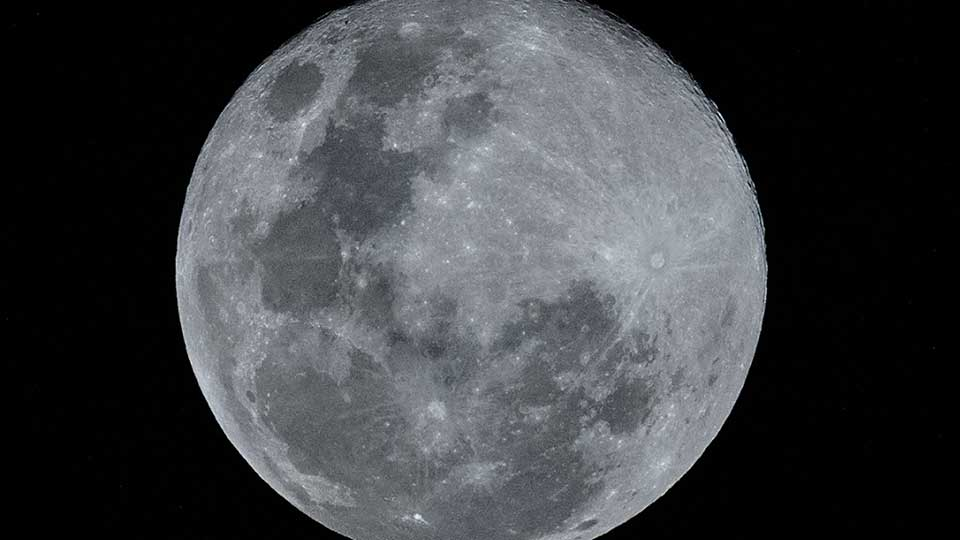 This picture taken on March 21, 2019 shows the last Supermoon of 2019, known as the 'super worm equinox moon', over Karak in Malaysia's Pahang state. - The last of three Supermoons which began the year, the 'worm moon' gets its name from folklore tradition, occurring at a time when frost on the ground melts and earthworms begin to emerge in temperate regions of the northern hemisphere.