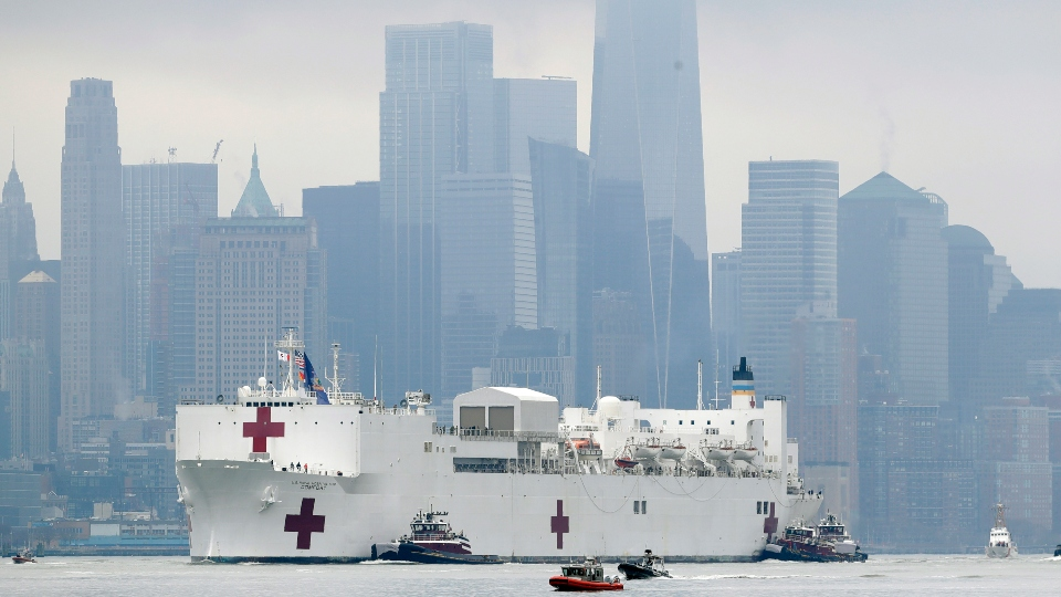 The Navy hospital ship USNS Comfort passes lower Manhattan on its way to docking in New York.