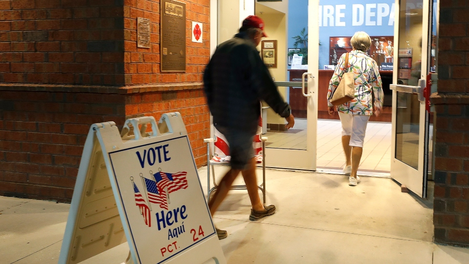 As mail voting pushed, some fear loss of in-person option.