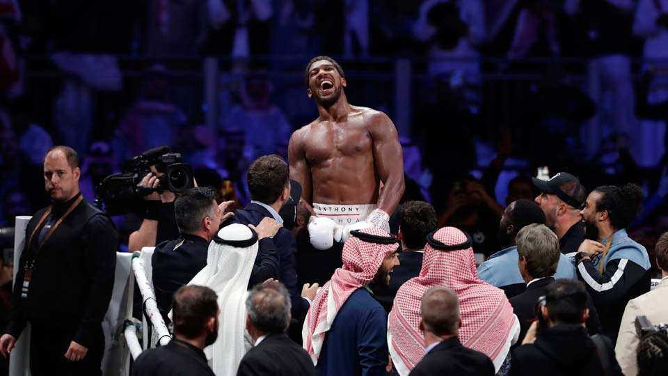 Britain's Anthony Joshua celebrates after beating Andy Ruiz Jr.