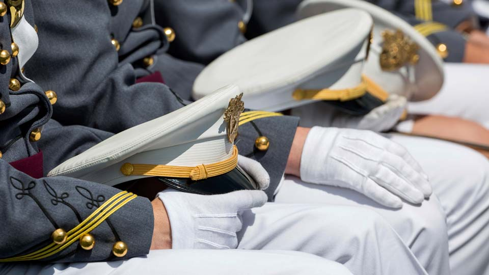 West Point cadets hold their caps on their laps during graduation ceremonies