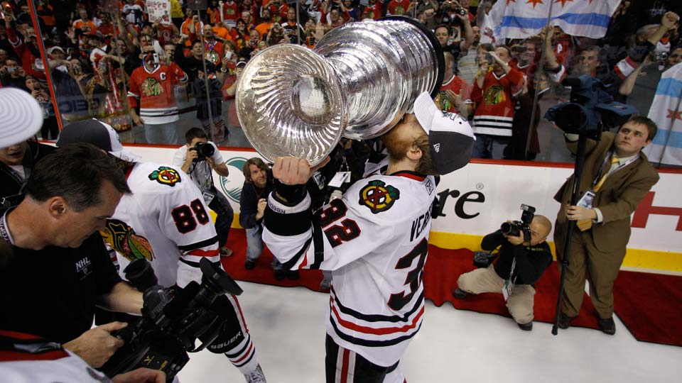 Chicago Blackhawks' Kris Versteeg celebrates with the Stanley Cup