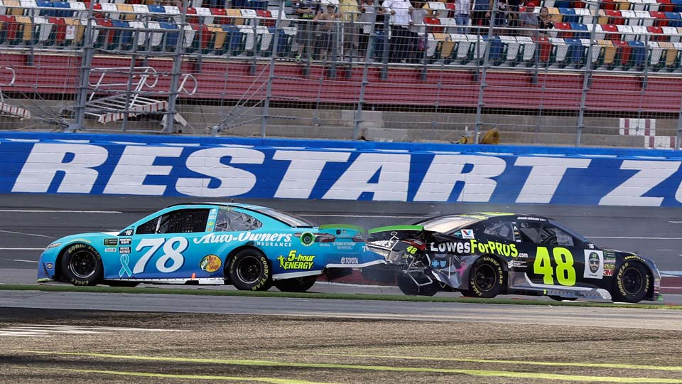 Martin Truex Jr., (78) and Jimmie Johnson (48) crash on the final lap during the NASCAR Cup series auto race at Charlotte Motor Speedway in Concord, N.C.