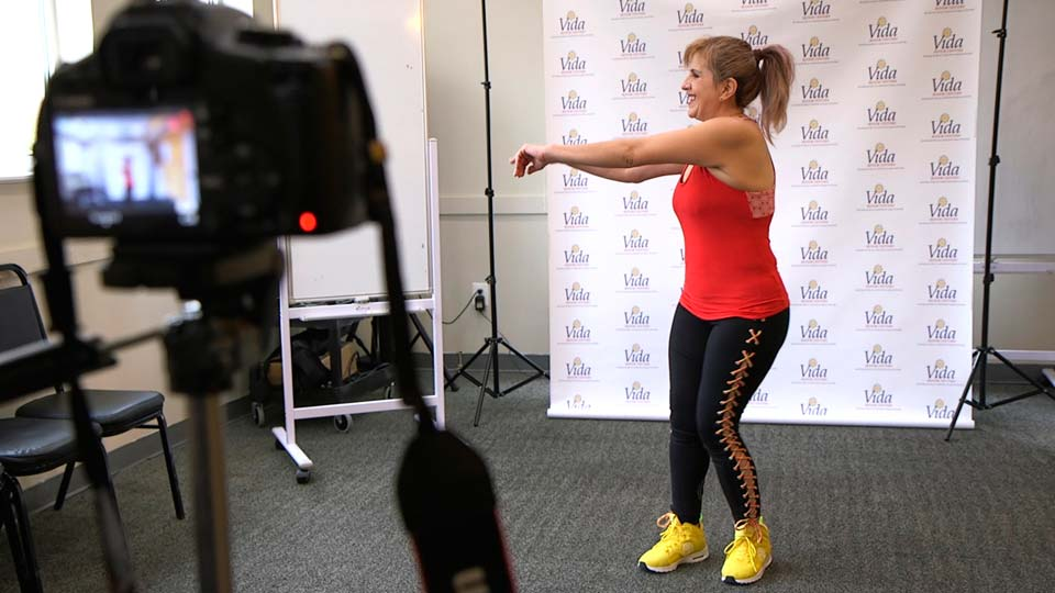 dance instructor Lola Jaramillo records a Zumba and exercise lesson in Washington