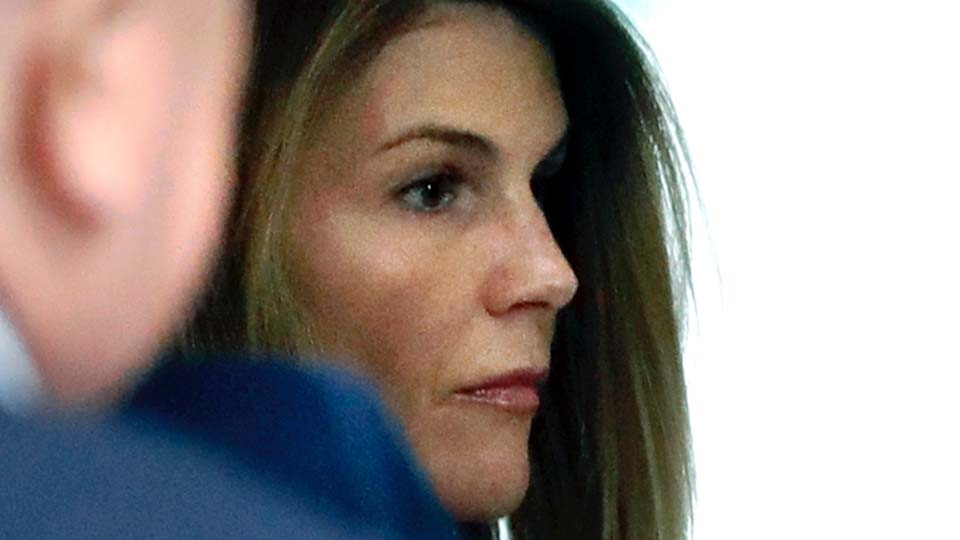 Lori Loughlin enters through the back door at federal court in Boston