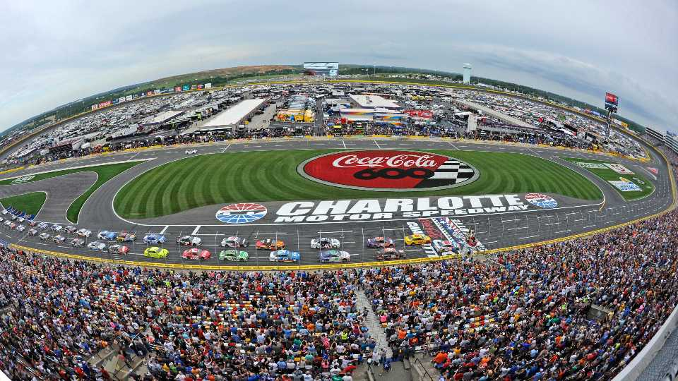 FILE - In this May 27, 2018, file photo, the field takes the green flag to start the NASCAR Cup Series auto race at Charlotte Motor Speedway in Concord, N.C. The governor of North Carolina says NASCAR can go forward with the Coca-Cola 600 at Charlotte Motor Speedway at the end of May so long as health conditions do not deteriorate in the state. Gov. Roy Cooper said Tuesday he and state public health officials have had discussions with NASCAR and the speedway regarding its safety protocols for staging a race without spectators. Cooper said the state offered input on NASCAR's plan, but he believes the race can go forward on Memorial Day weekend for the 60th consecutive year.