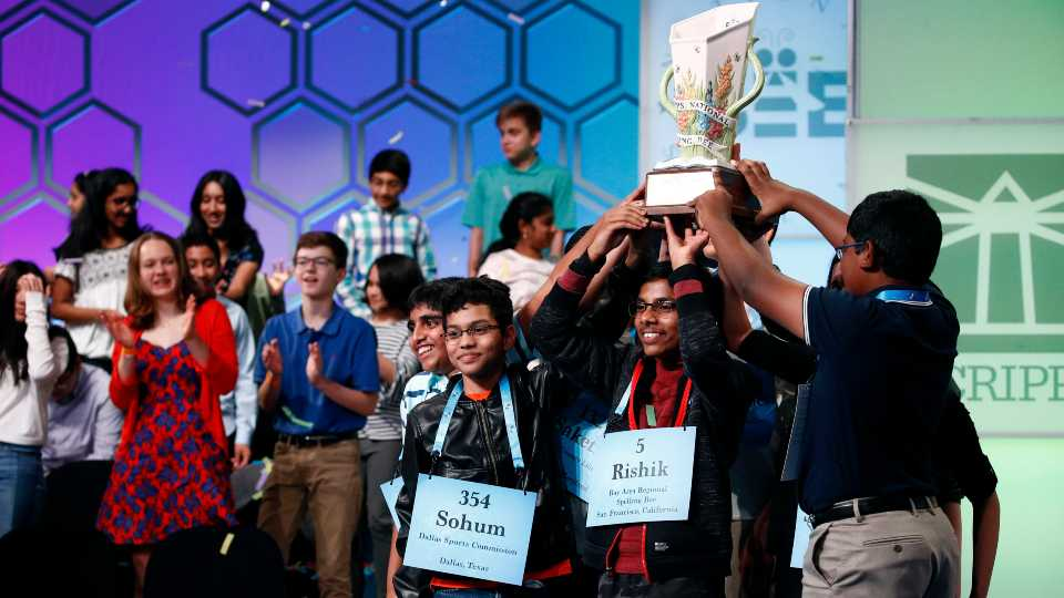 """In this May 31, 2019 file photos, eight co-champions celebrate after winning the Scripps National Spelling Bee, in Oxon Hill, Md. The Scripps National Spelling Bee has been canceled after organizers concluded there was """"no clear path to safely set a new date in 2020"""" because of the coronavirus pandemic."""