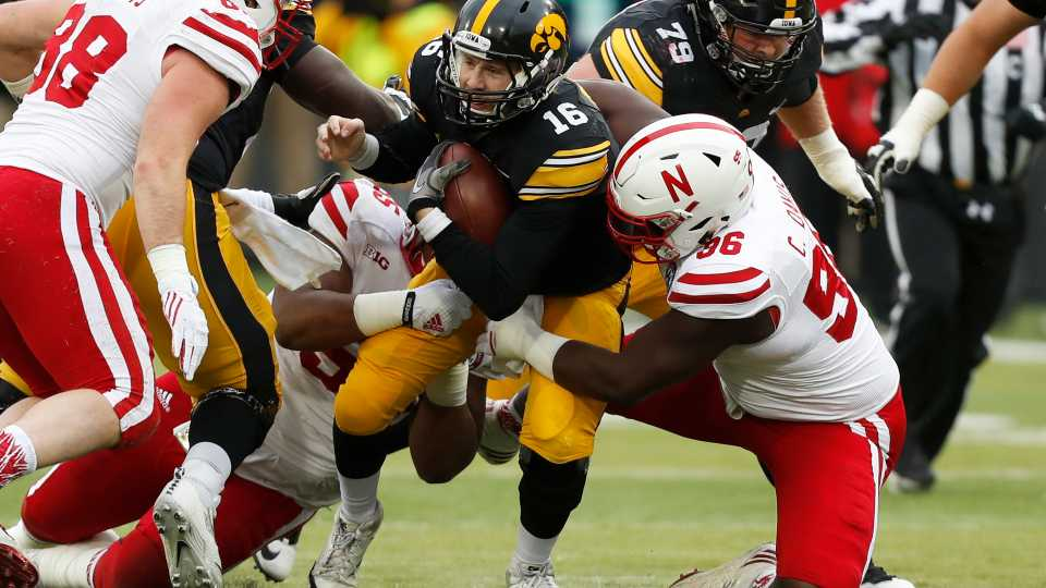 Iowa quarterback C.J. Beathard (16) is sacked by Nebraska defensive tackle Carlos Davis, right, during the first half of an NCAA college football game, Friday, Nov. 25, 2016, in Iowa City, Iowa.