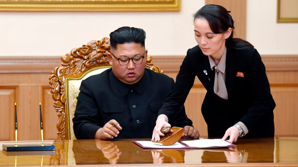 Kim Yo Jong, right, sister of North Korean leader Kim Jong Un, helps Kim sign joint statement following the summit with South Korean President Moon Jae-in at the Paekhwawon State Guesthouse in Pyongyang,