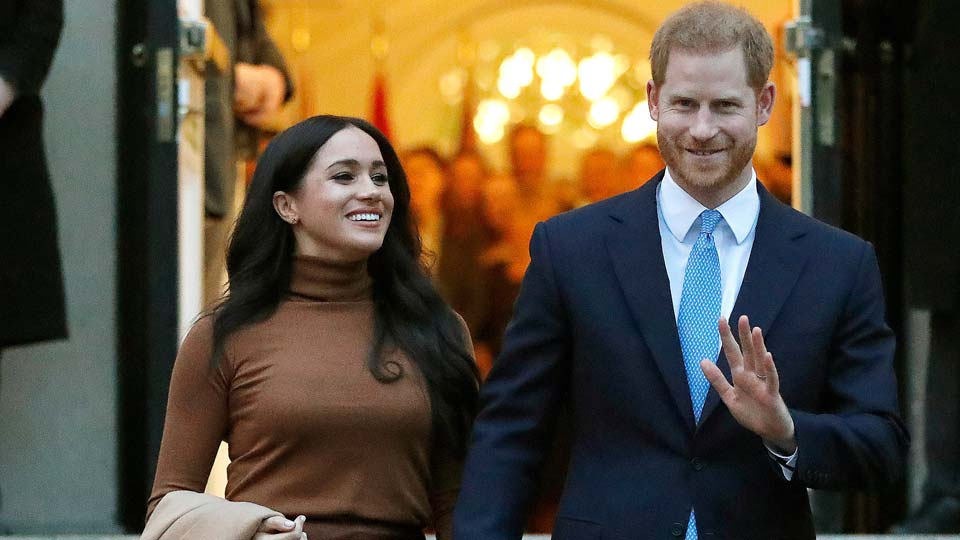 Britain's Prince Harry and Meghan, Duchess of Sussex leave after visiting Canada House in London