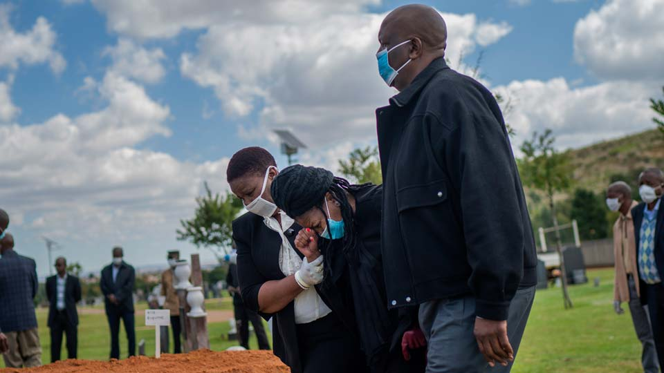 Relatives grieve Benedict Somi Vilakasi at his burial ceremony at the Nasrec Memorial Park outside Johannesburg