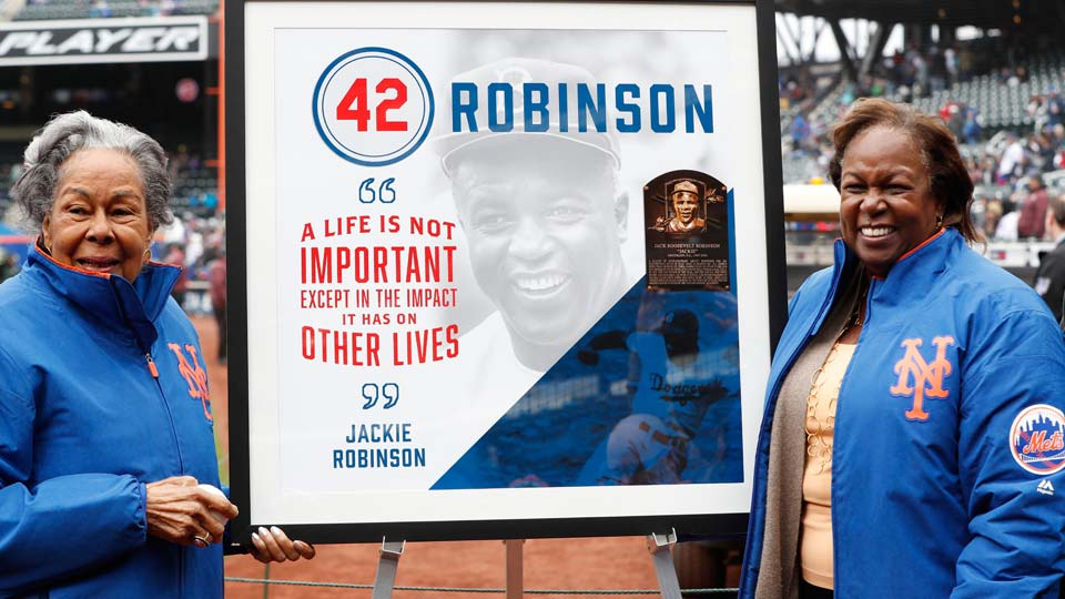 Rachel Robinson, left, widow of Jackie Robinson, and daughter Sharon pose for a photograph with a plaque honoring Jackie