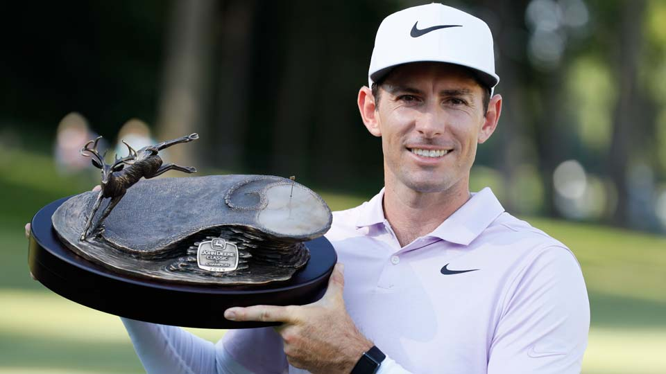 Dylan Frittelli holds the trophy after winning the John Deere Classic golf tournament, Sunday, July 14, 2019