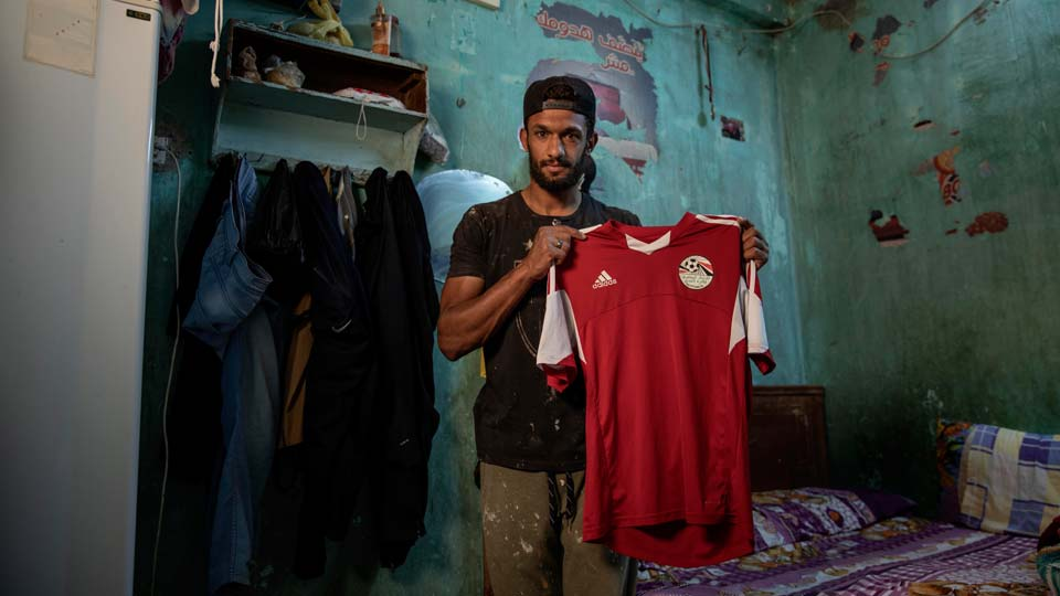 28-year-old defender Mahrous Mahmoud holds up his Egyptian national football team jersey