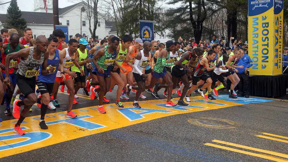 FILE - In this April 15, 2019, file photo, the elite men break from the start of the 123rd Boston Marathon in Hopkinton, Mass. The 2020 Boston Marathon, which was rescheduled to run on Sept. 14th, was canceled Thursday May 28, 2020 for the first time in its 124-year history due to the COVID-19 virus outbreak.