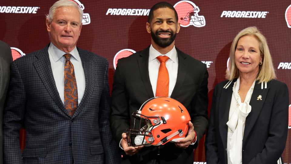 FILE - In this Feb. 5, 2020, file photo, Cleveland Browns general manager Andrew Berry, center, poses for a photo with owners Jimmy Haslam, left, and Dee Haslam, right, after speaking during a news conference at the NFL football team's training facility in Berea, Ohio. The Cleveland Browns have hired former 49ers executive Kwesi Adofo-Mensah as their new vice president of football operations under first-year general manager Andrew Berry.