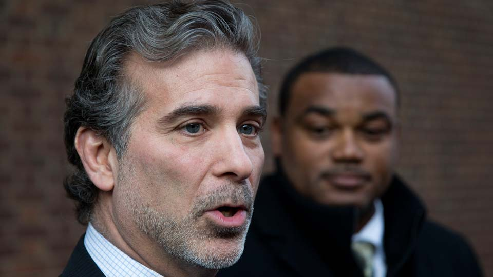 Co-lead players' lawyer Christopher Seeger, left, and client former NFL player Shawn Wooden