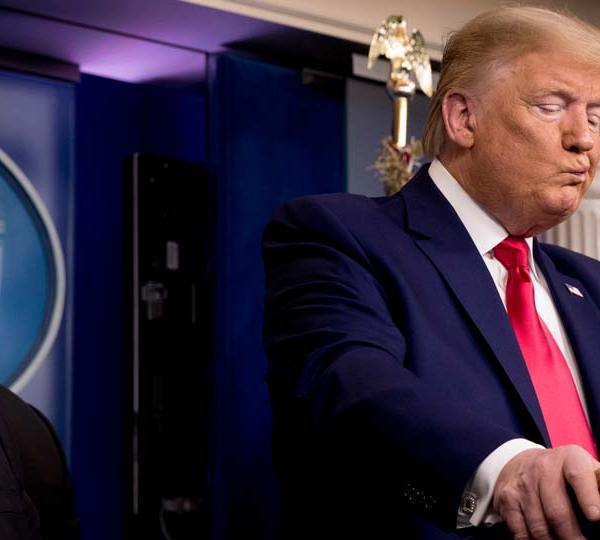 President Donald Trump, accompanied by, from left, National Institute for Allergy and Infectious Diseases Director Dr. Anthony Fauci