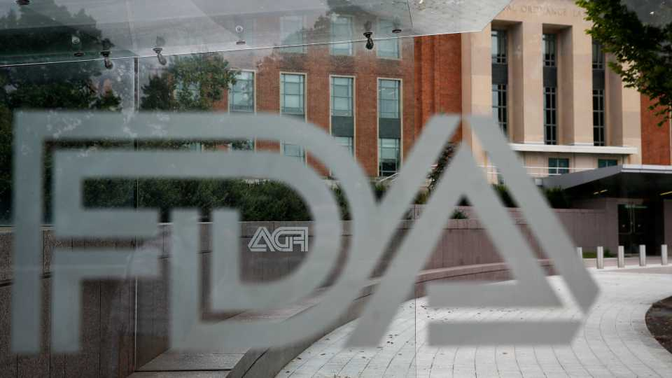 This Aug. 2, 2018, file photo shows the U.S. Food and Drug Administration building behind FDA logos at a bus stop on the agency's campus in Silver Spring, Md. U.S. regulators have approved a new type of coronavirus test that administration officials have touted as a key to opening up the country. The Food and Drug Administration on Saturday, May 9, 2020, announced emergency authorization for antigen tests developed by Quidel Corp. of San Diego. The test can rapidly detect fragments of virus proteins in samples collected from swabs inside the nasal cavity, the FDA said in a statement.