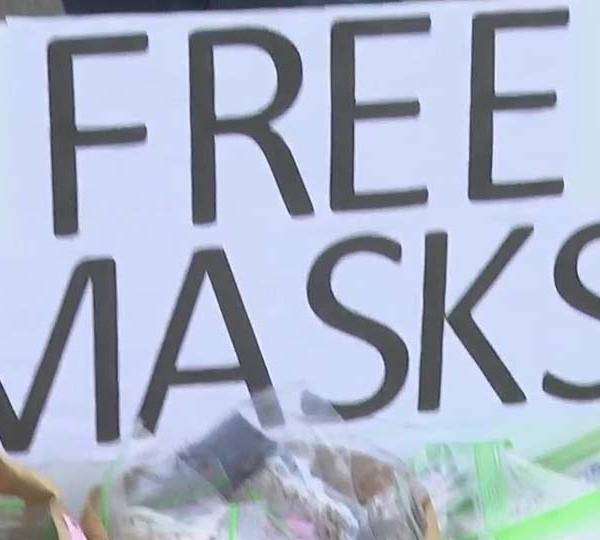 Group distributing free face masks in Sharon, Farrell