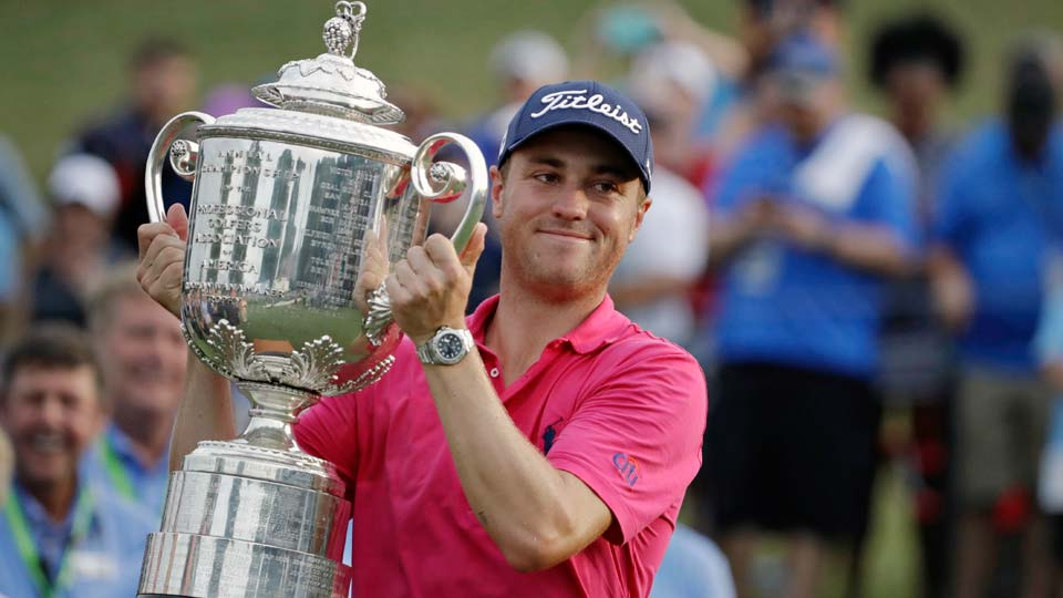 Justin Thomas poses with the Wanamaker Trophy after winning the PGA Championship golf tournament at the Quail Hollow Club in Charlotte, N.C.