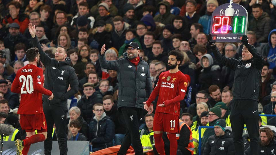 Liverpool's manager Jurgen Klopp, center, shouts out from the touchline as Liverpool's Adam Lallana, left, is substituted by Liverpool's Mohamed Salah during the English FA Cup