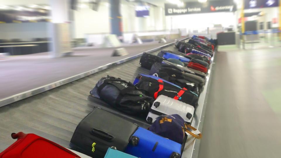 Luggage, baggage claim, airport, travel.
