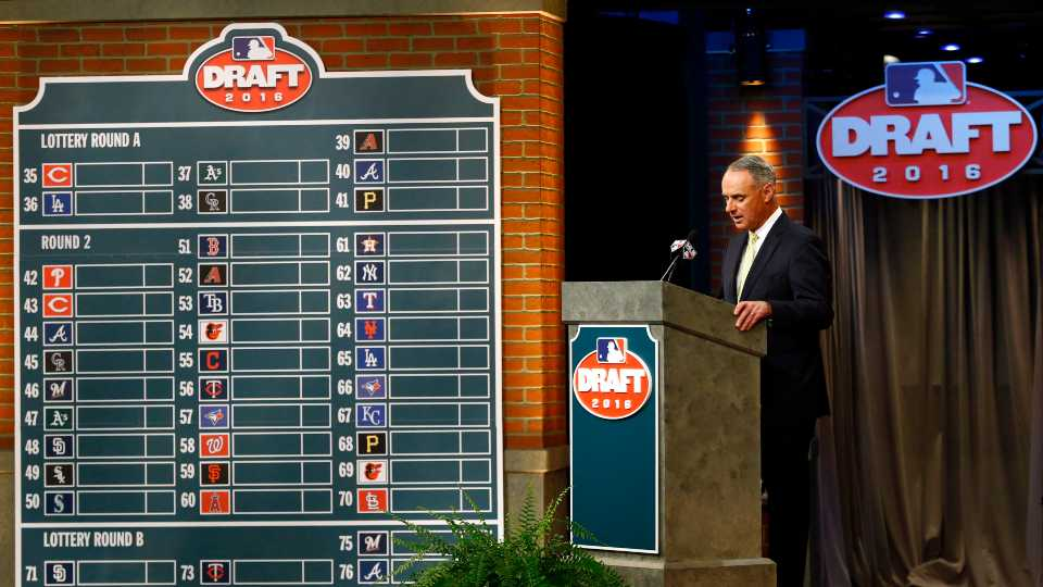 In this June 9, 2016, file photo, Major League BaseballCommissioner Rob Manfred speaks during the MLB draft, in Secaucus, N.J. Major League Baseball will cuts its amateur draft from 40 rounds to five this year, a move that figures to save teams about $30 million. Clubs gained the ability to reduce the draft as part of their March 26 agreement with the players' association and MLB plans to finalize a decision next week to go with the minimum, a person familiar with the decision told The Associated Press. The person spoke Friday, May 8, 2020, on condition of anonymity because no decision was announced