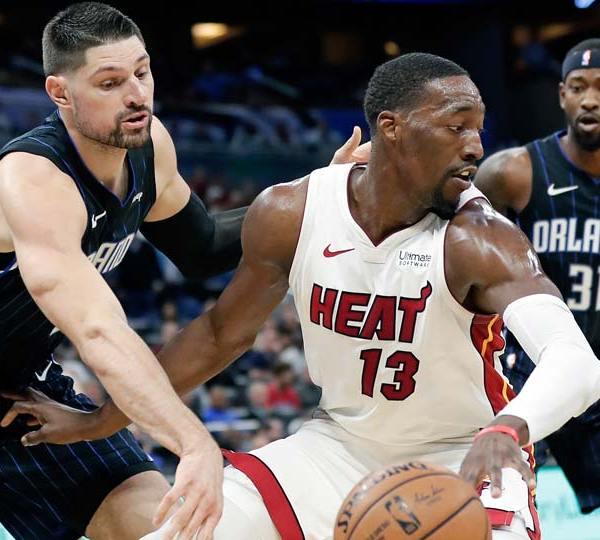 Miami Heat forward Bam Adebayo (13) tries to get around Orlando Magic center Nikola Vucevic, left, and guard Terrence Ross (31)
