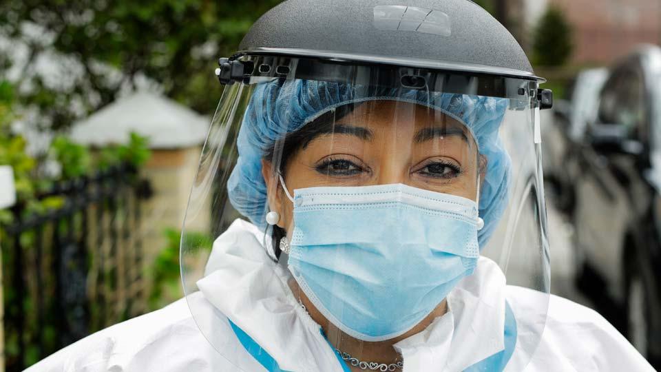 Linda Silva, a nurse's assistant, poses for a portrait in the Queens borough
