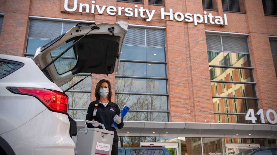 Senior Regional Outreach Coordinator Susan Prewitt prepares to deliver used COVID-19 test kits to be processed at The Ohio State University Wexner Medical Center.