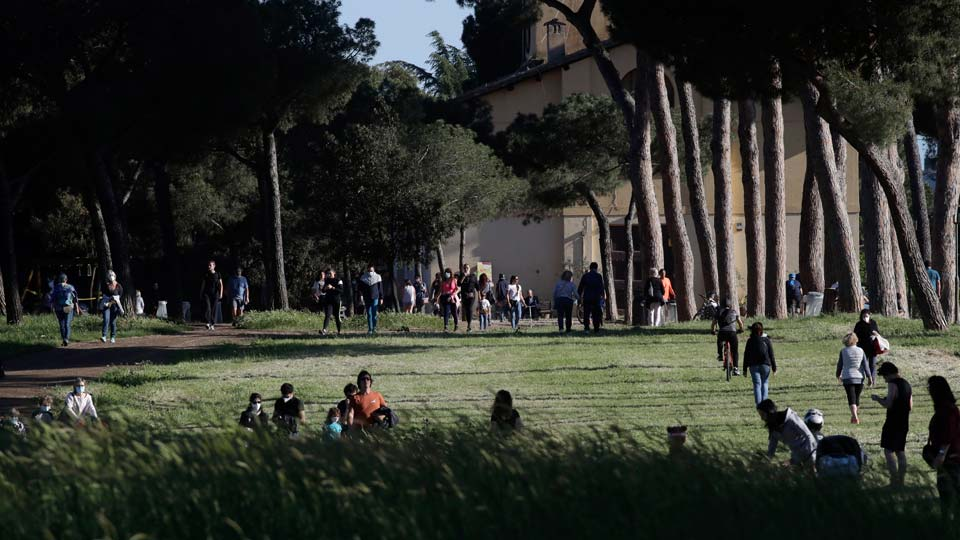 People gather inside Rome's Villa Pamphili park as it reopened after several weeks of closure