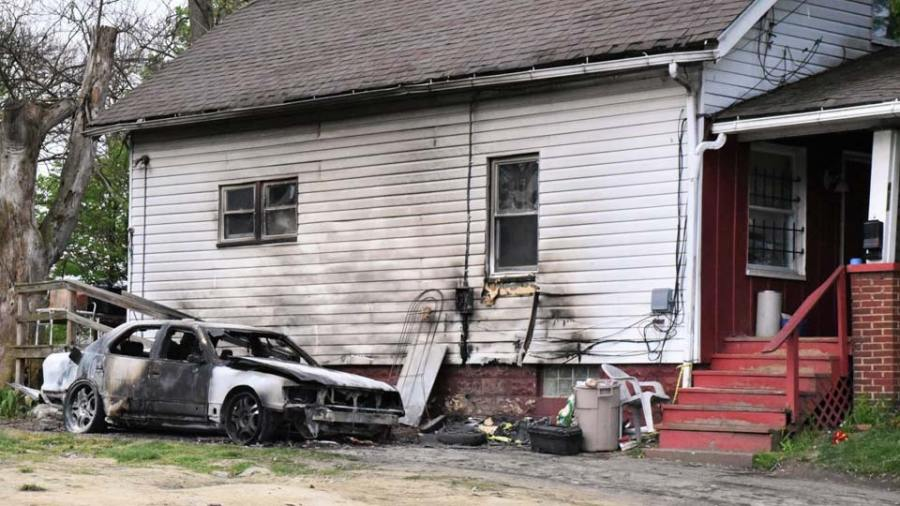 The damage caused by a fire to he car of Daniel Sims' nephew early Monday. Sims said he will be fixing up the house and towing the car. Sims' nephew was murdered in August in front of the house on West Marion Avenue - People of Youngstown 8