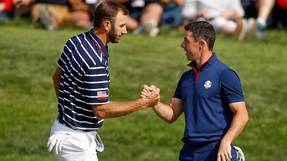 Dustin Johnson left, and Rory McIlroy shake hands