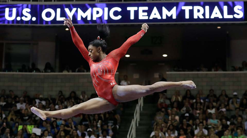 Simone Biles competes on the balance beam during the women's U.S. Olympic gymnastics trials