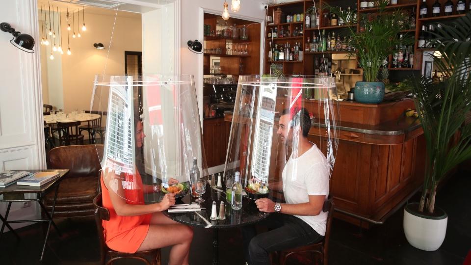 Patrons under plastic: Restaurants get creative in virus era.