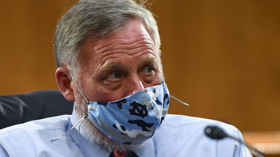 Burr steps aside as Senate intelligence chair amid FBI probe.