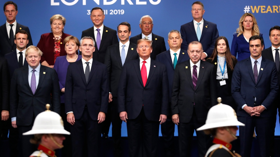 In this Dec. 4, 2019, file photo, world leaders attend a ceremony event during a NATO leaders meeting at The Grove hotel and resort in Watford, Hertfordshire, England.